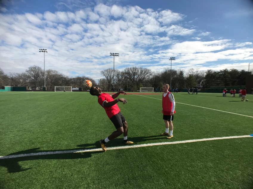 Two players juggle a soccer ball at Nashville SC's tryout.