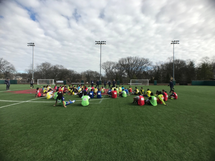 Nashville SC head coach talks to players at the end of the open tryout.