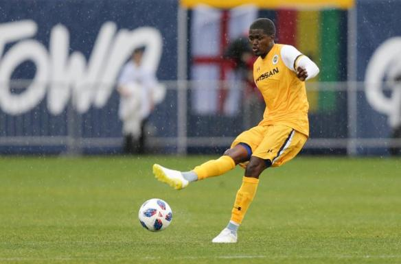 Lebo Moloto makes a pass for Nashville SC against Atlanta United FC at First Tennessee Park in Nashville.
