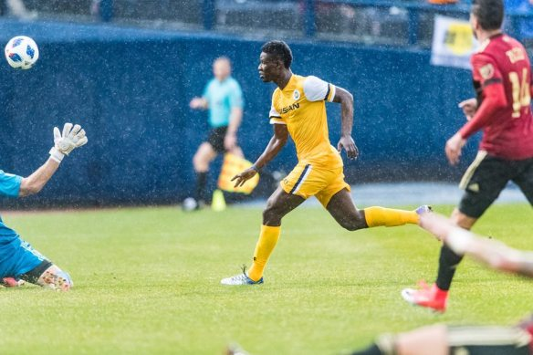 Ropapa Mensah scores the first professional goal for Nashville SC against Atlanta United FC on Feb. 10 at First Tennessee Park.