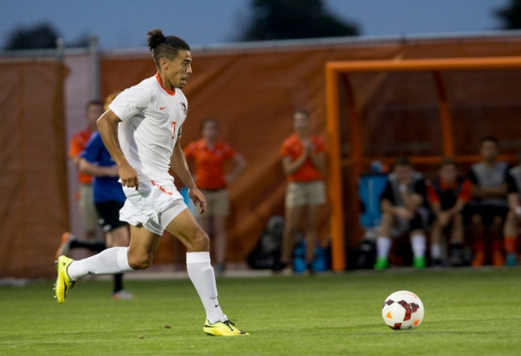 Ryan James dribbles a soccer ball playing for BGSU