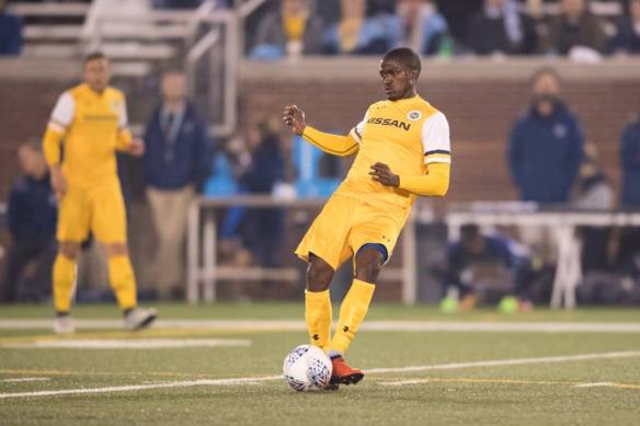 Lebo Moloto makes a pass for Nashville SC against Chattanooga FC.