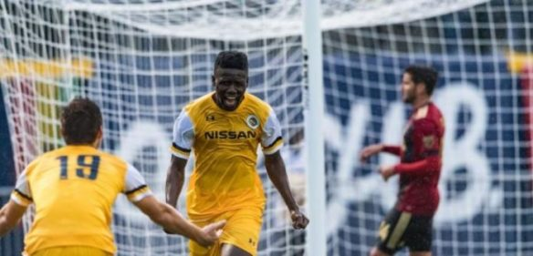 Ropapa Mensah celebrates after scoring Nashville SC's first goal against Atlanta United in a preseason match at First Tennessee Park.