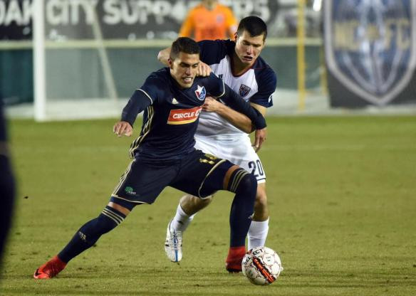 Indy Eleven's Karl Ouimette defends against North Carolina FC's Daniel Rios.