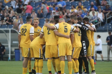 The starting 11 for Nashville SC says a quick final word to each other before the match against FC Cincinnati.